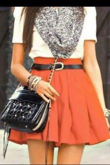 White short sleeve sweater, orange skirt, thin brown belt, black leather bag