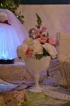 The small vintage wedding or bridal shower centerpiece designed by Kim's Bridal in a soft white with light pink roses is perfect for all the guest tables. For custom floral designs in Michigan call 734-639-1496