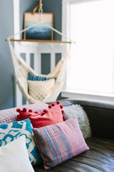 How to Add a Pop of Color for Less Than $100: Bright Throw Pillows Add a Colorful Spot to Cozy Sitting Area >> http://www.diynetwork.com/made-and-remade/learn-it/ways-to-add-a-pop-of-color-for-under--100?soc=pinterest