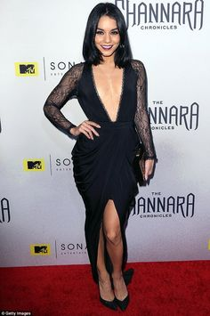 Taking the plunge: The 26-year-old picked a daring black gown which had a neckline that scooped all the way to her waist