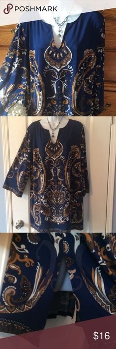 """INC Navy Paisley Tunic 92% polyester and 8% spandex. Good condition and light weight.  Approximately 32"""" in length and when measured laid flat from armpit to armpit it is 25"""" across. Colors are true navy and white and many colors of tans. 10"""" side slits as show in the third picture. Has some stretch.  Also has some silver bead embellishments on the front. INC International Concepts Tops Tunics"""