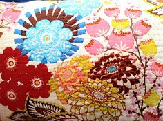 Anna Maria Horner fabric with hand-embroidery. Making a pillow like this for my mom for Christmas!