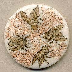 This button is scrimshaw on bone. The Honey Bee was selected as the State insect in 1992. The bee is essential to agriculture and a symbol of industry.