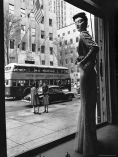 Women Standing on Sidewalk of 5th Avenue Across from Window of Saks Department Store by A. Eisenstaed, NY 1942.
