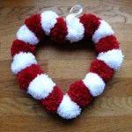 Valentine's Pom Pom Wreath - thread 18 pom poms through general purpose garden wire, form into a heart, twist the ends. Valentine Wreath, Valentine Day Crafts, Holiday Crafts, Pom Pom Wreath, Pom Pom Rug, Pom Pom Crafts, Yarn Crafts, Crafts To Make And Sell, How To Make Wreaths