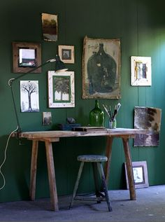 Great green; nice arrangement of artwork, and rustic table/desk is quite suitably contrasting.