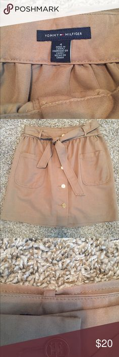 Tommy Hilfiger Skirt Size 4 Stylish brown Tommy Hilfiger skirt with a cute belt. 5 Tommy Hilfiger gold buttons down the front. Only worn 2 times. Tommy Hilfiger Skirts A-Line or Full
