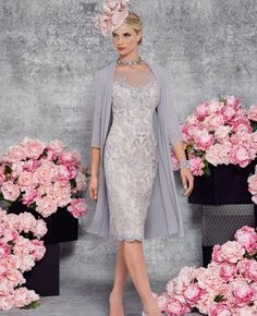 A SLIM FIT LACE DRESS WITH ¾ LENGTH MESH SLEEVES, ILLUSION NECKLINE AND BACK WITH SCALLOPED EDGING AND MATCHING CHIFFON JACKET CHIFFON, LACE, MESH Veni Infantino is an internationally recognised designer for The Mother of the Bride and evening wear. She has bought her own signature to classic tailoring using beautiful silks and lace in …