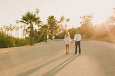 Downtown LA engagement shoot, palm trees, pink balloons, highway, freeway, LA traffic, brown wedges