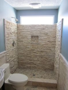 I love stone, but this would be a disaster to clean or to even try and clean, it's a great feature wall just not inside the shower but this is only my opinion :)