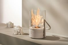 Instead of a candle, get this mini fireplace!