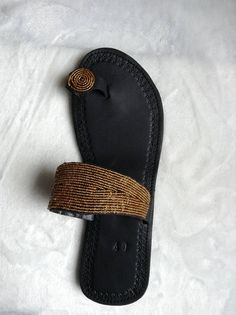 0c4c4fc030c9 The beautiful and colorful sandal is made from soft leather and Maasai beads .