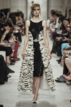Chanel Cruise collection SS14...stylish look or a summer version of Crudelia Demon?