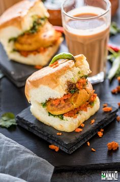 Mumbai Vada Pav placed on a black coaster with glass of chai and bowls of chutney in the background Vada Pav Recipe, Indian Snacks, Indian Food Recipes, Amazing Food Photography, Mumbai Street Food, Food Stall, South Indian Food, Food Illustrations, Food Cravings