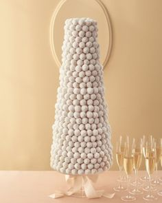Unique Wedding Cakes - Instead of croquembouche, this cake features cake balls. Guests can pluck them off themselves, or caterers can serve a few on each plate with or without a slice of sheet cake of the same flavors. Themed Wedding Cakes, White Wedding Cakes, Unique Wedding Cakes, Unique Weddings, Wedding Ideas, Wedding Inspiration, Wedding Cookies, Cake Wedding, Wedding Favors
