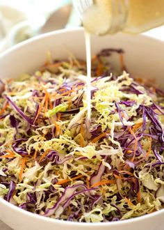 RECIPETIN EATS - Cabbage Salad Dressing - Vinaigrette being poured over Everyday Cabbage Salad in a white bowl Cabbage Salad Recipes, Slaw Recipes, Cabbage Slaw, Healthy Salad Recipes, Asian Cabbage Salad, Salad Bar, Soup And Salad, Pasta Salad, Healthy Cooking