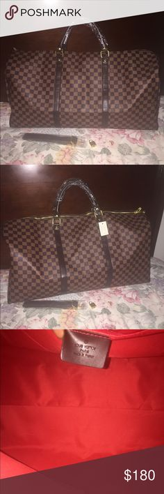 Louis Vuitton Duffle bag Brand new. Damier style. Nice quality. Comes with lock, key, and strap. Louis Vuitton Bags Travel Bags