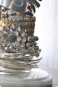Repurposed Jewelry Storage - thrift store marble paper towel holder for those bulky bangles.