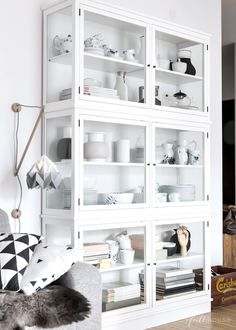 Simple white glass cabinet in the scandinavian styled interior. Home Living Room, Interior Design Living Room, Living Room Designs, Dining Room Storage, Book Storage, Storage Boxes, Glass Cabinet Doors, Glass Cabinets, My New Room