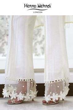 Best 11 Designer Indian & Pakistani White Embellished Trousers available in Salwar Trousers, Embroidered Trousers and Bootcut trousers. Designed in London UK. Free delivery over White raw silk trousers with flowers and pearl embellishment. ̴Ì_These Salwar Designs, Blouse Designs, Kurti Designs Pakistani, Pakistani Outfits, Indian Outfits, Pakistani White Dress, Fashion Pants, Fashion Dresses, Stylish Dresses