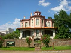 Ace of Clubs House in Texarkana, TX.   History: Has 3 groups of octagonal rooms (leaves of a club) opening on a rotunda backed by long rectangular rooms (the Club's stem). Rotunda has a marble mantel, French mirrors and spiral stairway and is topped with 20-foot tower. Built 1884 by J. H. Draughan. Owned since 1894 by Henry Moore family. Recorded Texas Historic Landmark - 1964 #HistoricalMarker #HistoricHomes #OldHouses #Houses #Homes