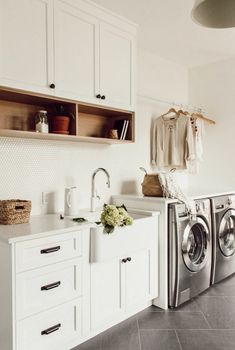 Impressive Bohemian Laundry Room Ideas To Inspire You - Its one of the most used rooms in the house but it never gets a makeover. What room is it? The laundry room. Almost every home has a laundry room and . Laundry Room Tile, Garage Laundry, Modern Laundry Rooms, Room Tiles, Laundry Room Organization, Laundry Room Design, Laundry Drying, Laundry Closet, Laundry Decor