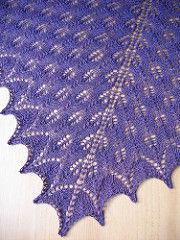 The dramatic swirl of stitches on this shawl is created by Fir Cone lace, a traditional pattern from the Shetland Islands that is simple to knit and easy to memorize.