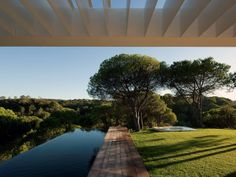 Architect Pedro Reis- infinity pool perpendicular to the home rather than parallel