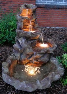 Fiberglass construction is very resistant to weathering and is also easy to clean. Though with the look of real stone, this fountain doesn't have the enormous weight of natural rock, making it more manageable and easy to move. Fitted with a strong electric pump. Also included are halogen lights which illuminate each basin bowl at night.