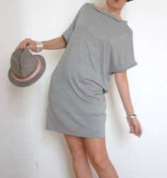 is a long T-shirt, gray, made of a soft and fresh stretch viscose. It has a boat neckline and short sleeve.  You can wear it as short dress, bare legs, or as a long top with pants or skirt. This large t-shirt has an edge side which may turn on itself liberate the walls of his pants and turn it into a simple t-shirt (as in photo 5).  It is also perfect for the beach as cover-ups  for my collections womens clothing using fabrics made in Italy that come from prestigious companies in northern…