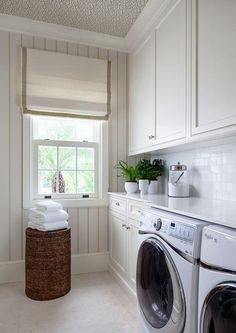 White Laundry Room with Wallpaper on Ceiling