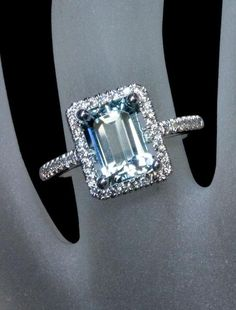 halo emerald cut aquamarine engagement ring