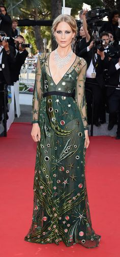 British model Poppy Delevingne wearing a Burberry gown on the Cannes red carpet for the premiere of 'Carol'