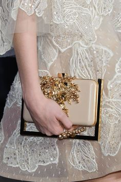 Elie Saab It's not couture until you have superfluous golden frame around a beaded clutch.