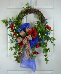 American Patriotic of July Floral Front Door Wreath by Gaslight Floral Design.⦁ Unique handmade design ⦁ Measurement tip to tip ⦁ Quality silk materials ⦁ High-temperature glue ⦁ Grapevine wreath ⦁ Ready for shipment Unique Front Doors, Front Door Decor, Wreaths For Front Door, Front Porch, Mesh Wreaths, Burlap Wreaths, Patriotic Wreath, 4th Of July Wreath, American Flag Wreath