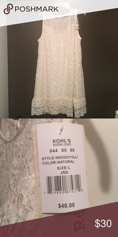 NWT off white lace dress. NWT off white lace summer dress. Has a sheer lining. Purchased for trip but never wore. rewind Dresses Midi