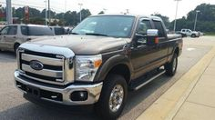 """IMMACULATE CONDITION!  2015 Ford F-250 SRW 4x4 Crew Cab, XLT trim, 156"""" WB Styleside., 6.2L EFI V-8 engine, 6 speed automatic CONTACT LAFAYETTE FORD: 5202 Raeford Road, Fayetteville, NC 888-591-6778 -- lafayetteford.comtransmission, chrome package, aluminum wheels, air conditioning, cruise, SYNC, remote keyless entry, reverse vehicle aid sensor, rearview camera, Sirius satellite radio, AM/FM CD, trailer hitch, tow hooks and lots more!"""