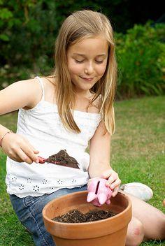Young girl planting a piggy bank Piggy Bank, Planting, Pictures, Plants, Money Box, Money Bank, Savings Jar