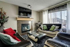 Spacious family room that is open to the kitchen . Diamond Realty & Associates Ltd. Corner Pantry, Maple Cabinets, Large Family Rooms, Fee Simple, Basement Bedrooms, Selling Real Estate, Private Room, Floor Finishes, Gas Fireplace