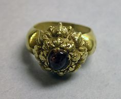 Stirrup-shaped Ring with Purple Circular Stone  Period: Central Javanese period Date: Second half of the 8th–second half of the 10th century Culture: Indonesia (Java) Medium: Gold with purple stone