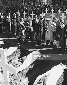 German civilians of Ludwigsluts Germany file past the graves of the 200 victims of starvation and torture in the Nazi concentration camp near...