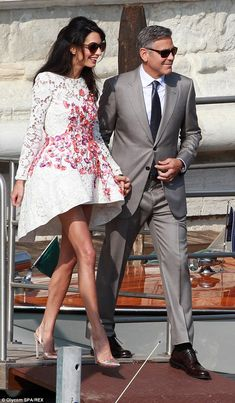 Amal Alamuddin, 36, stepped out in a lace long-sleeved Giambattista Valli dress dotted with bright flowers