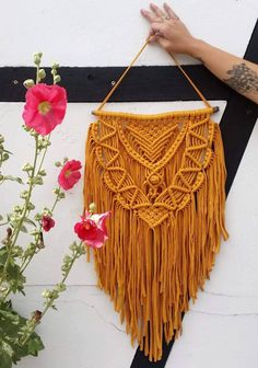GOLDIE - large macramé wall hanging in a wonderful mustard yellow, made from driftwood and elastic ribbon by WildAndFeather on Etsy https://www.etsy.com/au/listing/537640904/goldie-large-macrame-wall-hanging-in-a