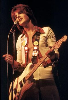 Eric Faulkner performing live on stage with the Bay City Rollers in 1976 in Copenhagen Denmark