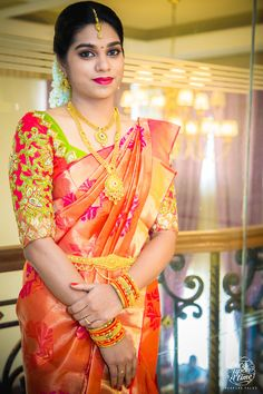 South Indian bride. Gold Indian bridal jewelry.Temple jewelry. Jhumkis.Orange silk kanchipuram sari.braid with fresh jasmine flowers. Tamil bride. Telugu bride. Kannada bride. Hindu bride. Malayalee bride.Kerala bride.South Indian wedding.