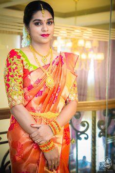 South Indian bride. Gold Indian bridal jewelry.Temple jewelry. Jhumkis.Orange silk kanchipuram sari.braid with fresh jasmine flowers. Tamil bride. Telugu bride. Kannada bride. Hindu bride. Malayalee bride.Kerala bride.South Indian wedding.