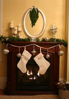Mercury Glass Christmas Mantel - i could use the candle holders from the wedding