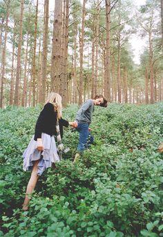 Forest walks hand-in-hand.
