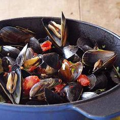 Spicy Grilled Mussels get smoky as they sit over a charcoal grill