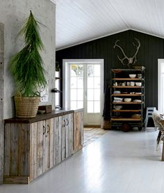 Love these shelves for the kitchen | This Norwegian Christmas cabin decor oozes a relaxed atmosphere where vintage finds mix in beautifully with new home decor and a reclaimed kitchen.